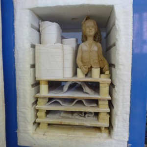 kiln loading with tiles, limoges and Nuala's sculptures